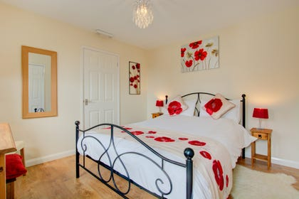 Cheerful double bedroom, with ironwork double bed.