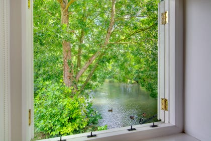 Stunning view of river from window.