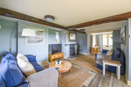Spacious Sitting Room with woodburner