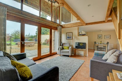 Open Plan Living Room - Spacious with comfortable seating and doors to garden