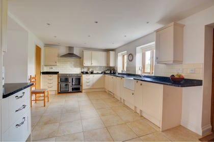 Modern kitchen with with electric range cooker, fridge freezer, dishwasher, microwave, washing machine and tumble dryer