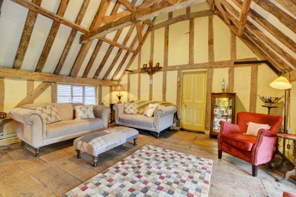 Cosy Sitting Room with characterful beams and comfortable seating