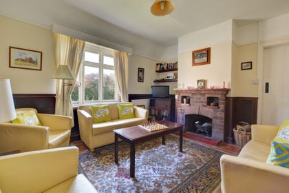 The sitting room is traditionally furnished and has an open fire - coal and wood supplied, for cosy evenings