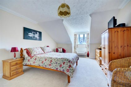 Bedroom one is a spacious room with double bed and en suite