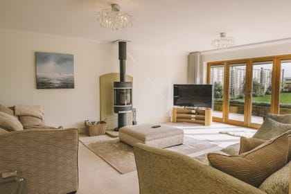 Sitting room showing comfortable seating and woodburner